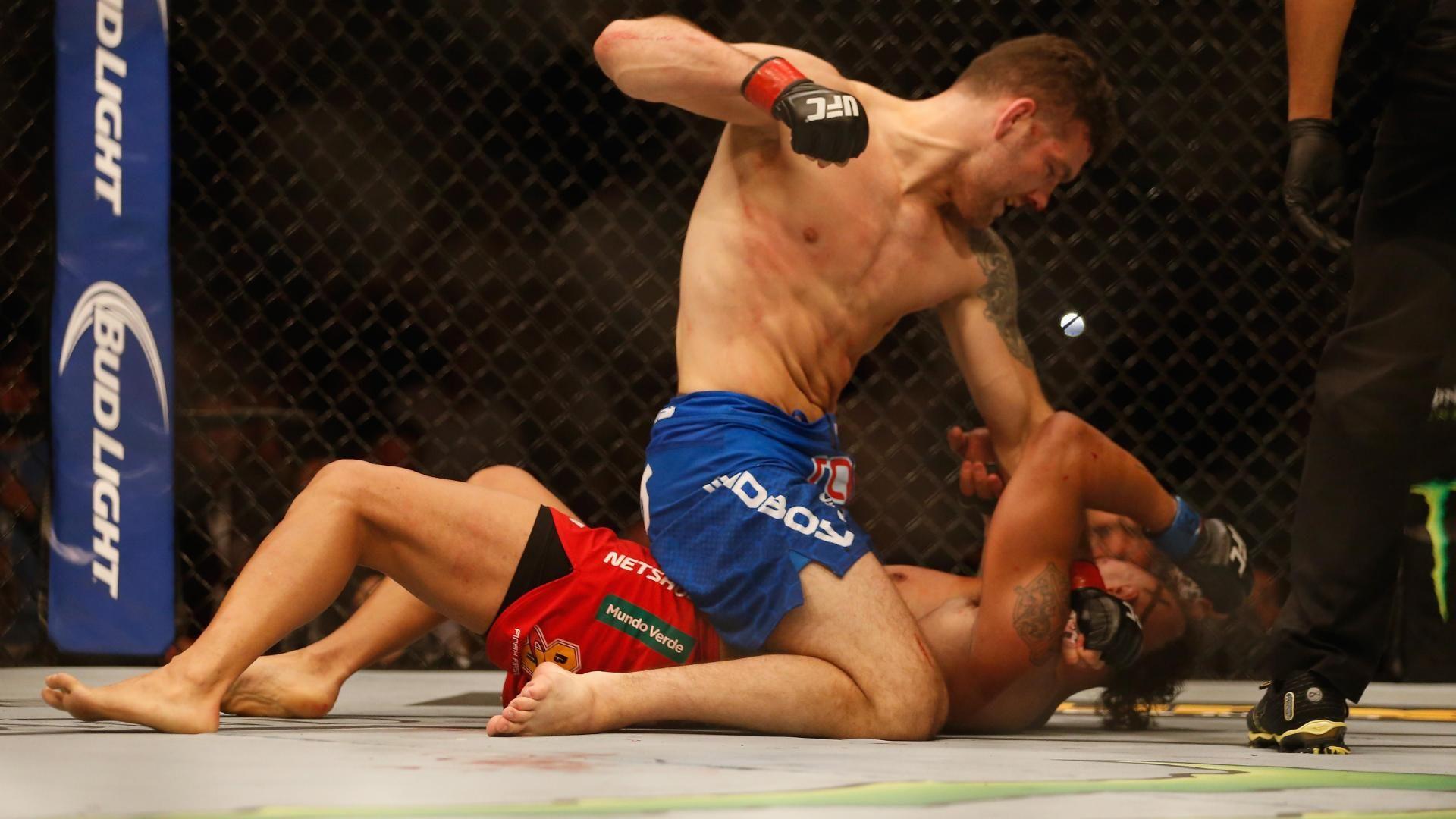 Weidman wins by TKO to retain belt