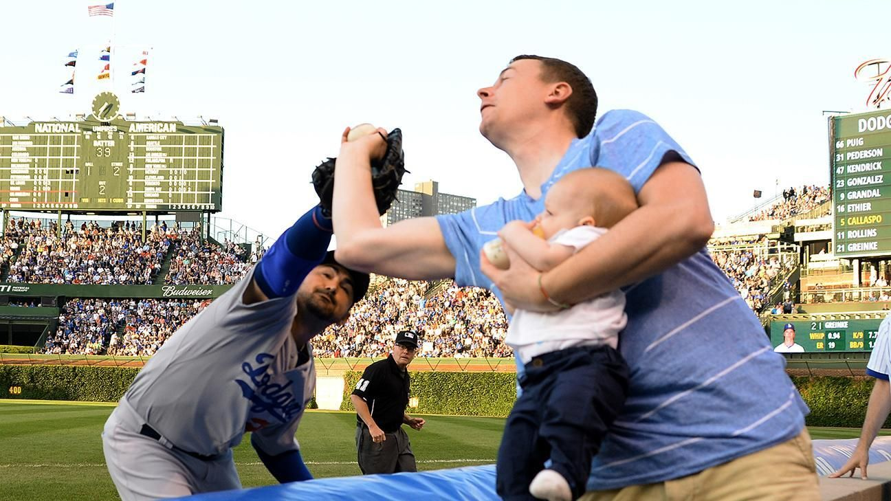 Fan makes great catch while feeding baby