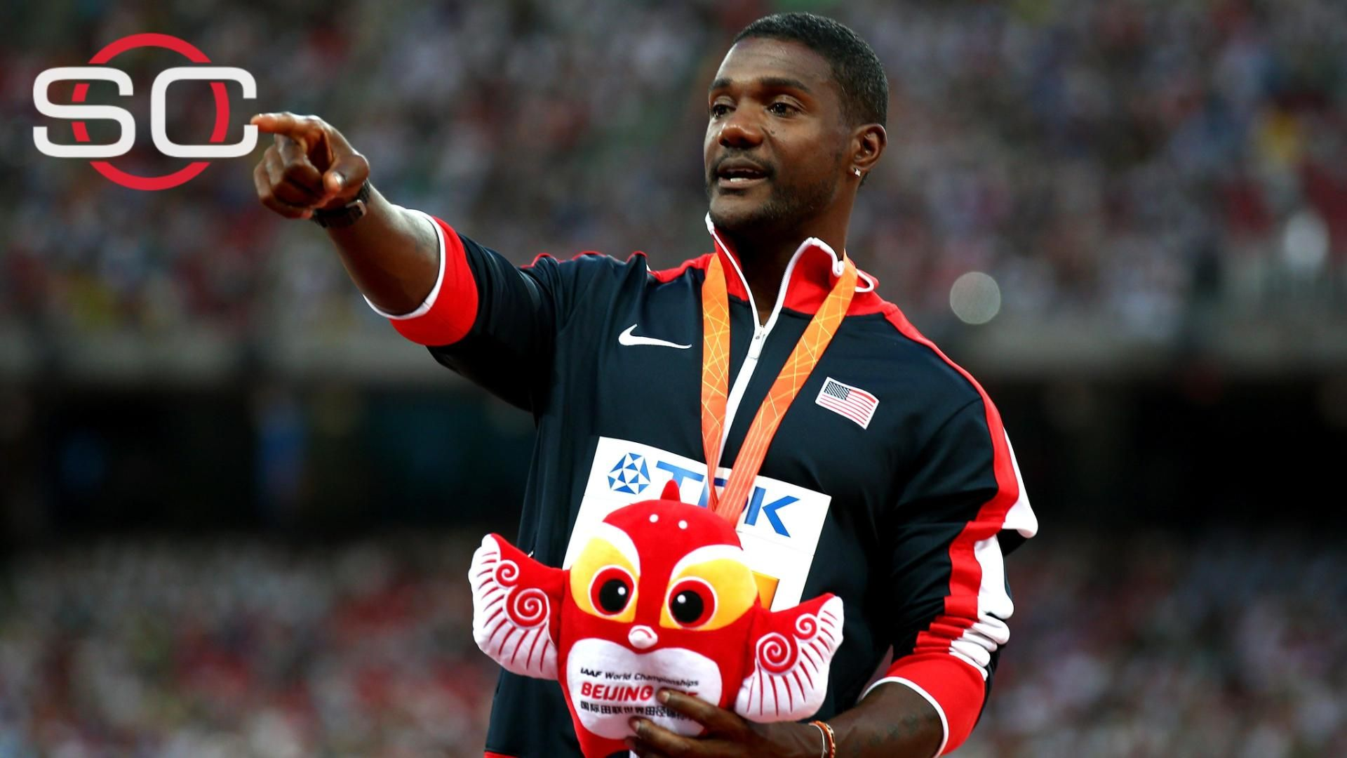 Gatlin defends mom, calls out heckler from podium