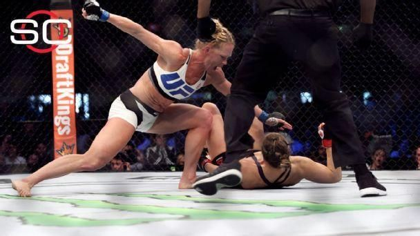 https://secure.espncdn.com/combiner/i?img=/media/motion/2015/1115/dm_151115_SC_Rousey_Hold_Highlight403/dm_151115_SC_Rousey_Hold_Highlight403.jpg