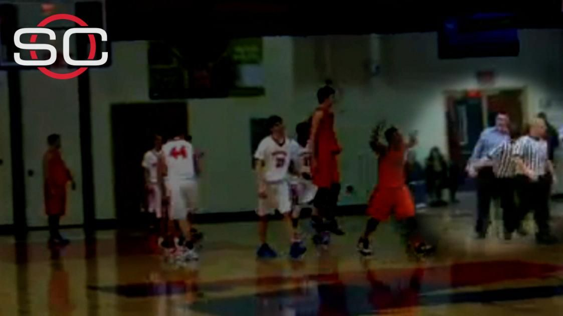 HS basketball coach appears to head-butt referee