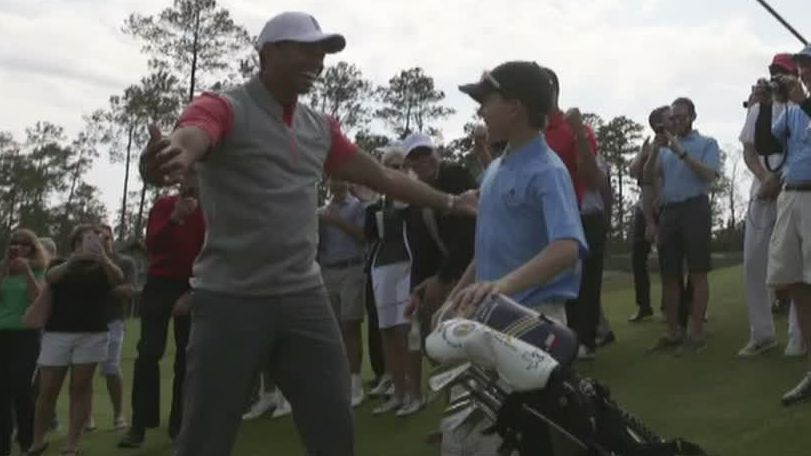 Kid impresses Tiger Woods with hole-in-one