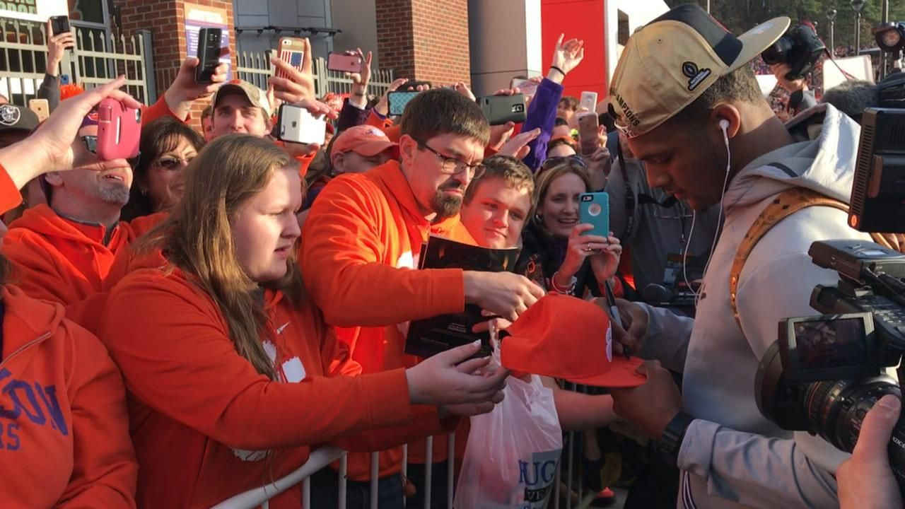 Watson greeted off the bus by the Clemson faithful
