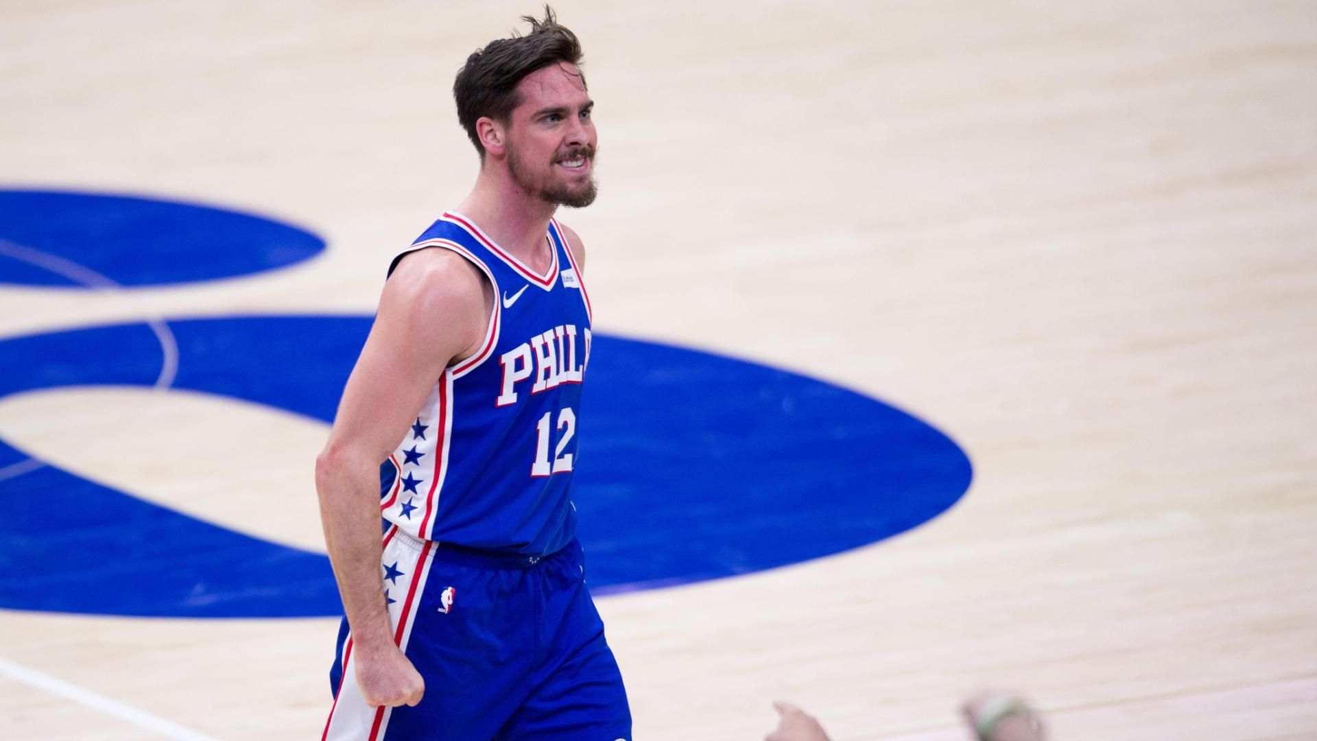 McConnell's triple-double paces Philly to win
