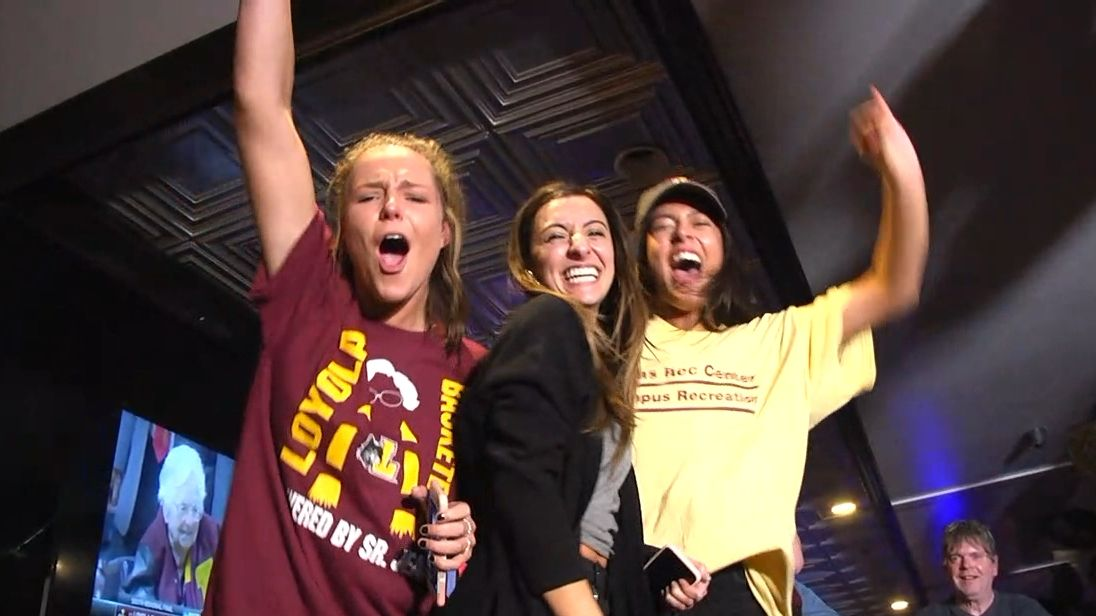 Loyola fans climb on bar in celebration