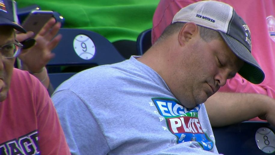 Fan fast asleep at College World Series