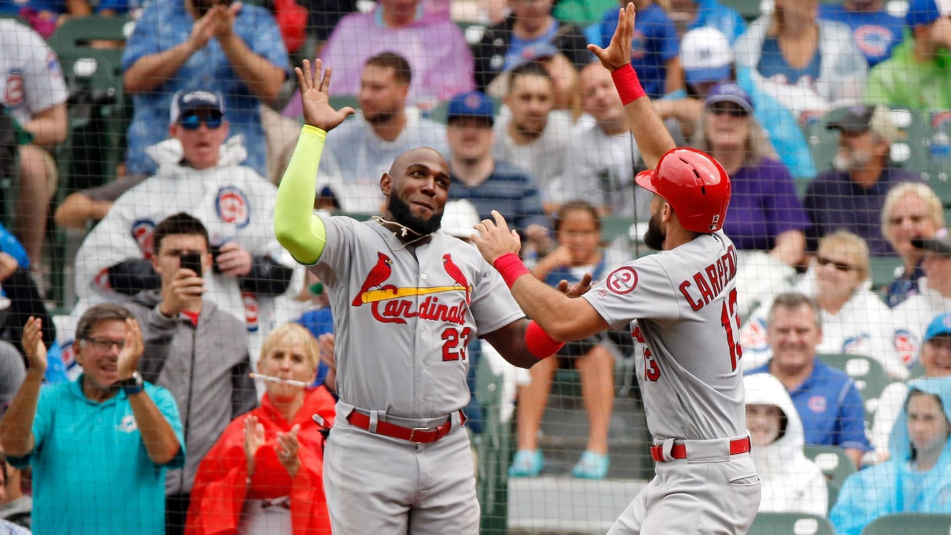 Carpenter hits three homers in victory