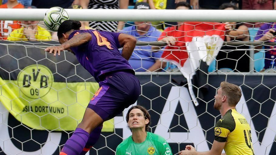Van Dijk's header puts Liverpool ahead