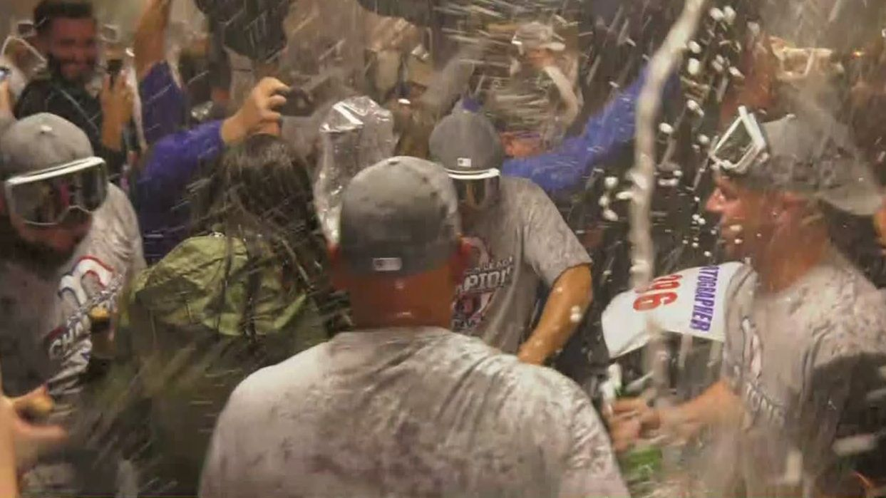 Red Sox let the champagne flow in locker room