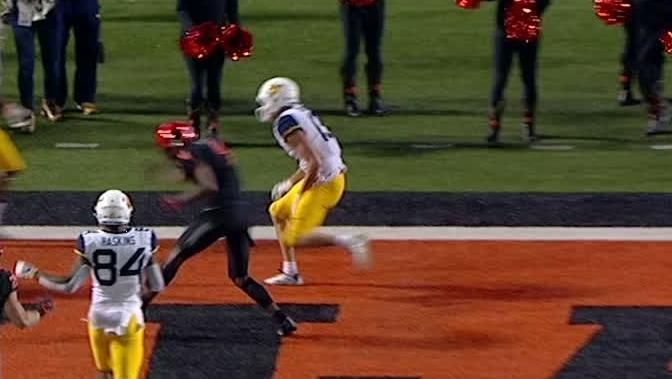 Oklahoma State's late TD, big stop seal upset of West Virginia