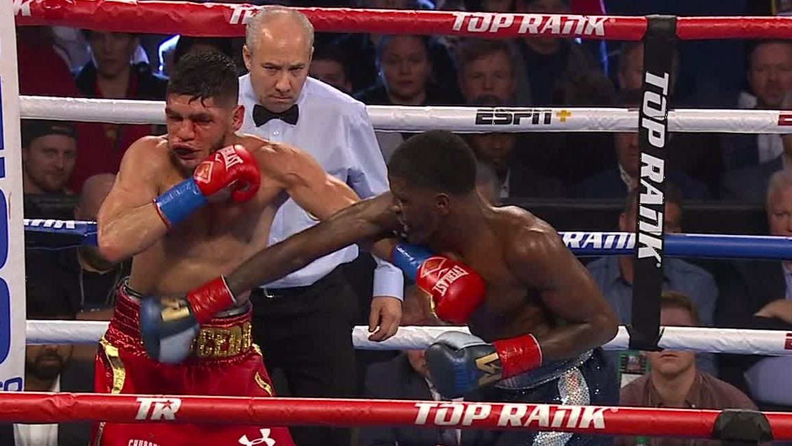 Hooker retains belt with wild TKO victory over Saucedo
