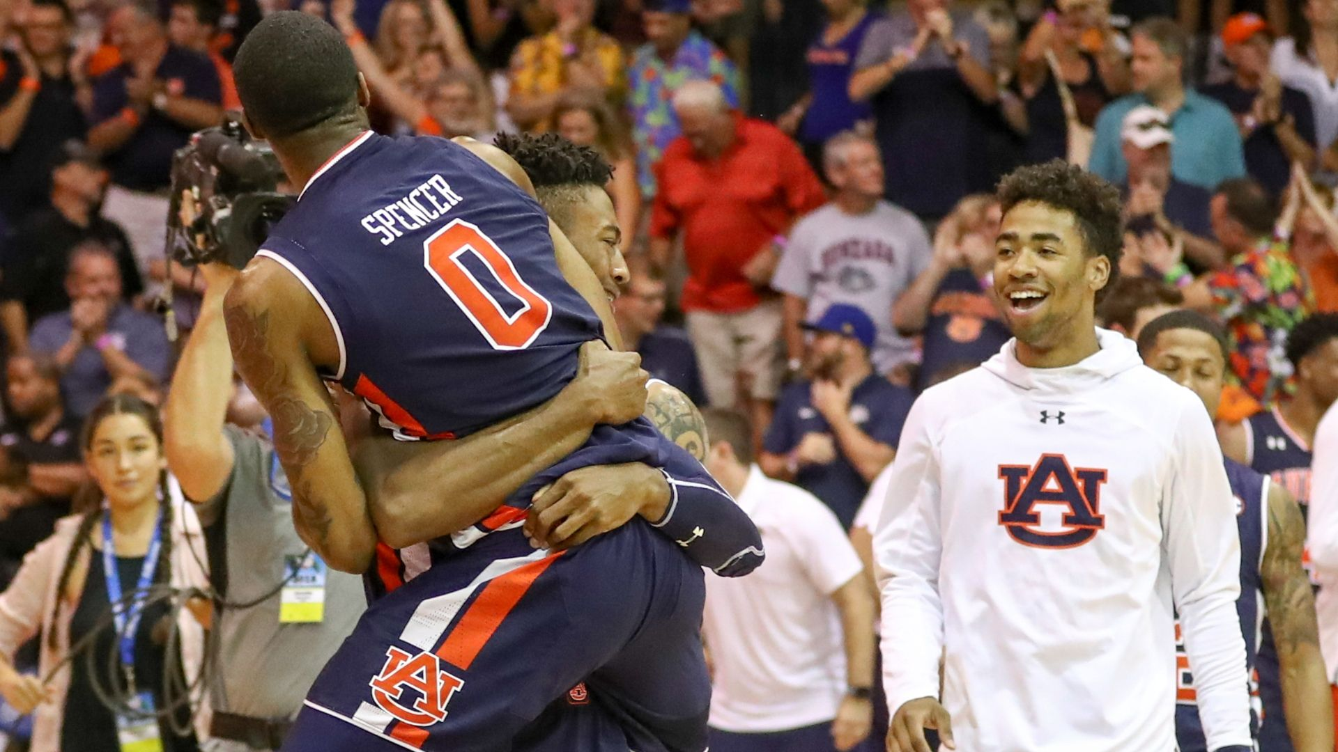 Auburn wins in OT with help of Harper's 25 points.