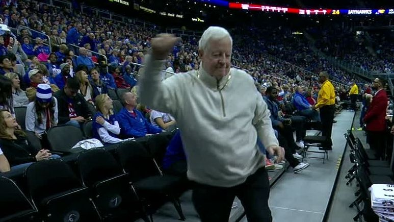 Kansas fan dances out of his shoes during timeout