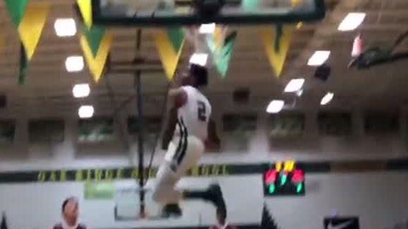 Oak Ridge's Glover pulls of crazy 360-between-the-legs dunk