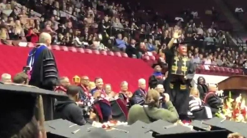 Hurts receives standing ovation at graduation