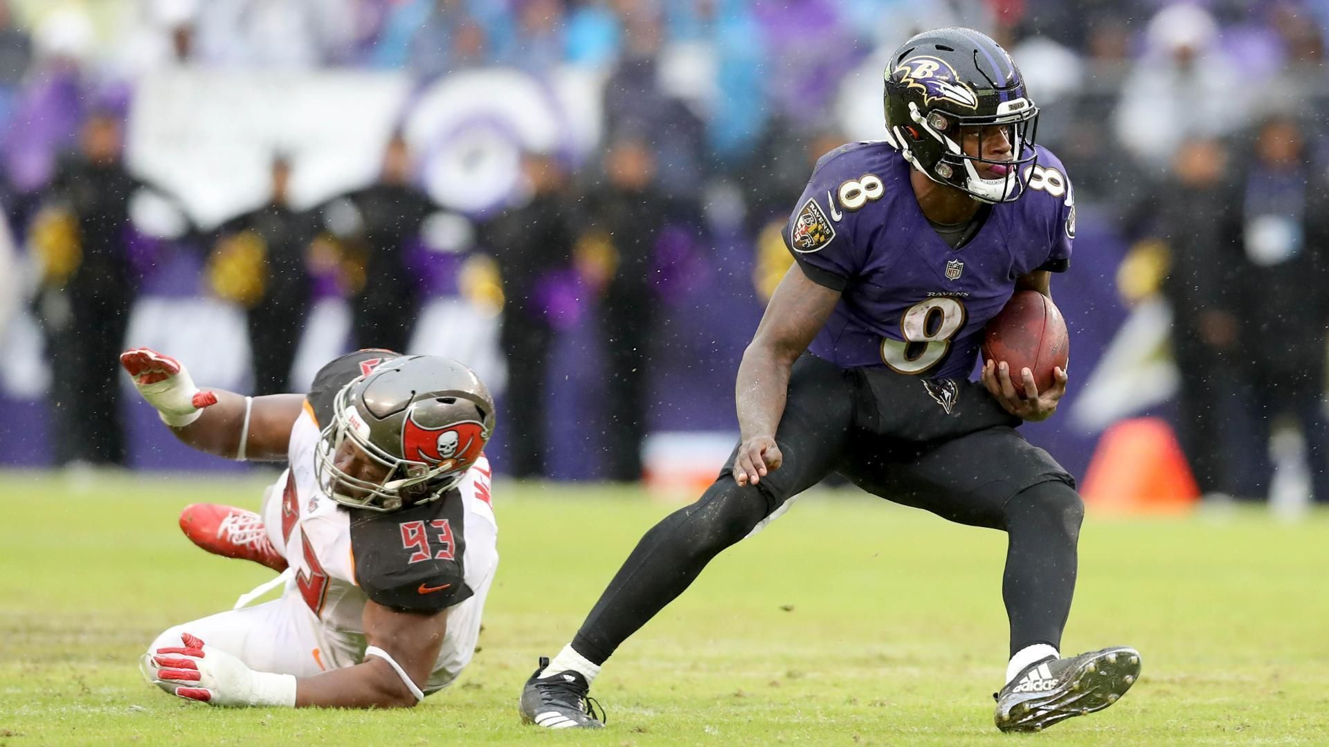 Jackson's arm and legs spur Ravens past Buccaneers