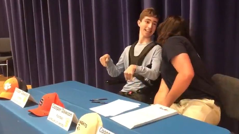 Recruit has friend help with college announcement
