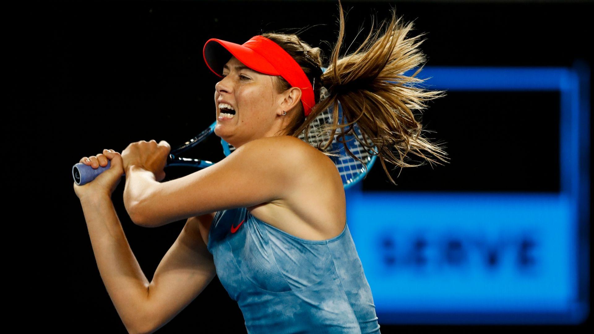 Sharapova advances to set up showdown with Wozniacki