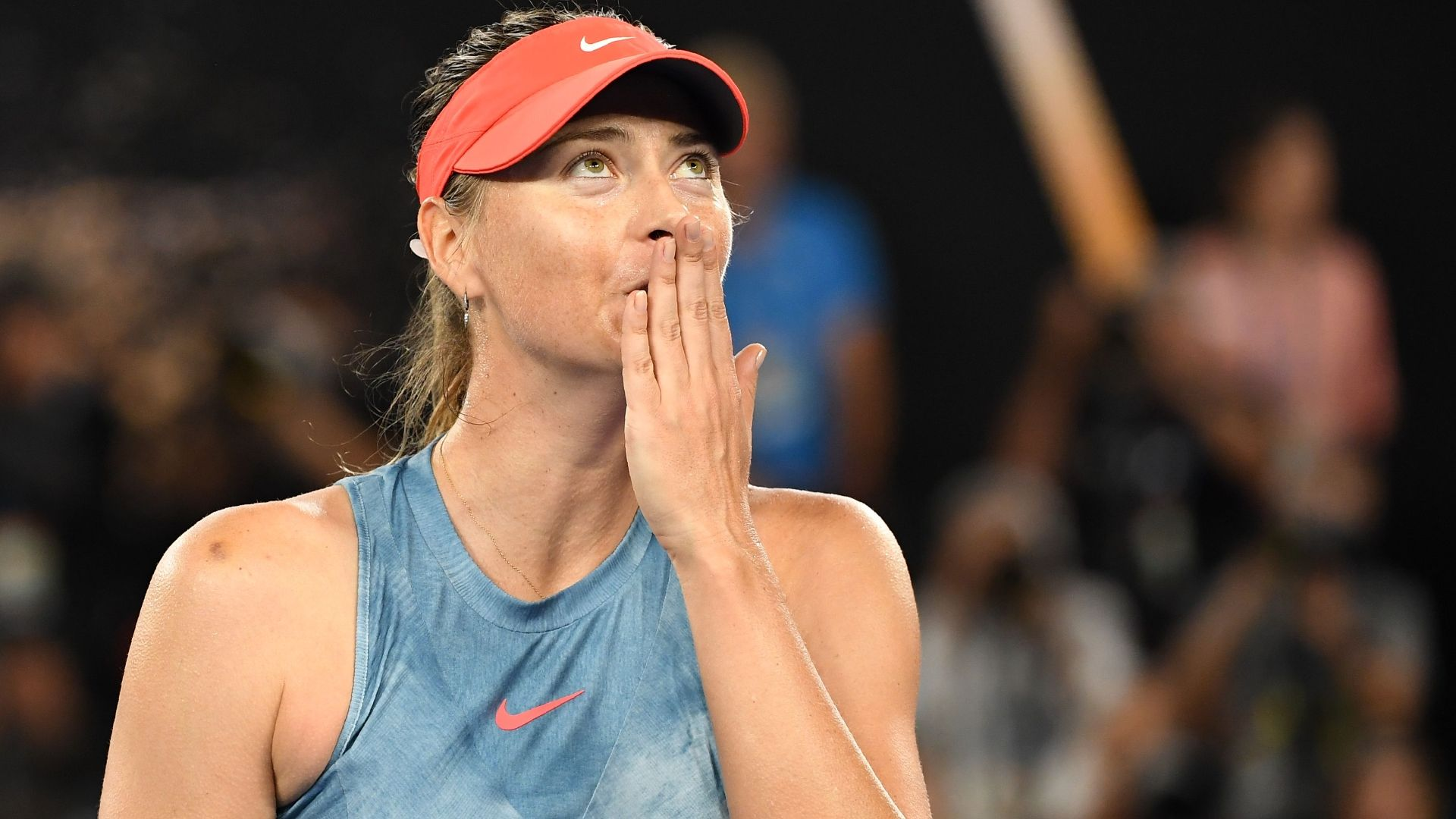 Sharapova upsets defending champion Wozniacki in Australia