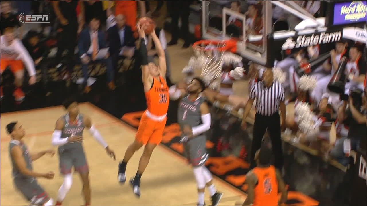Oklahoma State's Carroll dunks down with authority