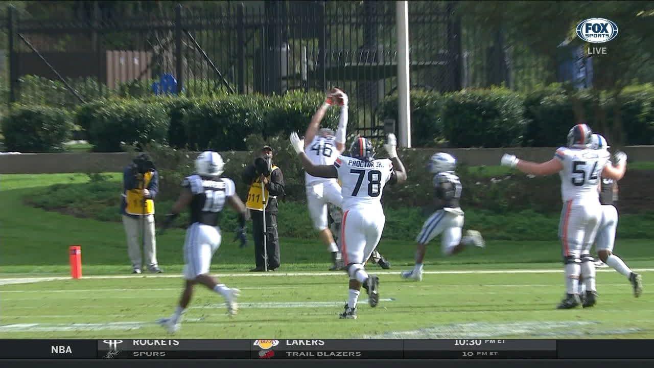 UVA's Perkins escapes and floats a 16-yard TD pass